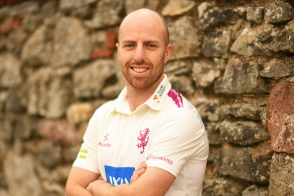 Jack Leach cricketer stood with arms crossed.