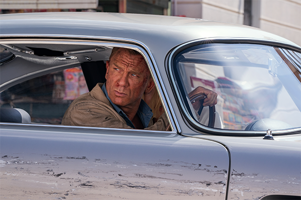 An action shot of james bond driving a scratched car