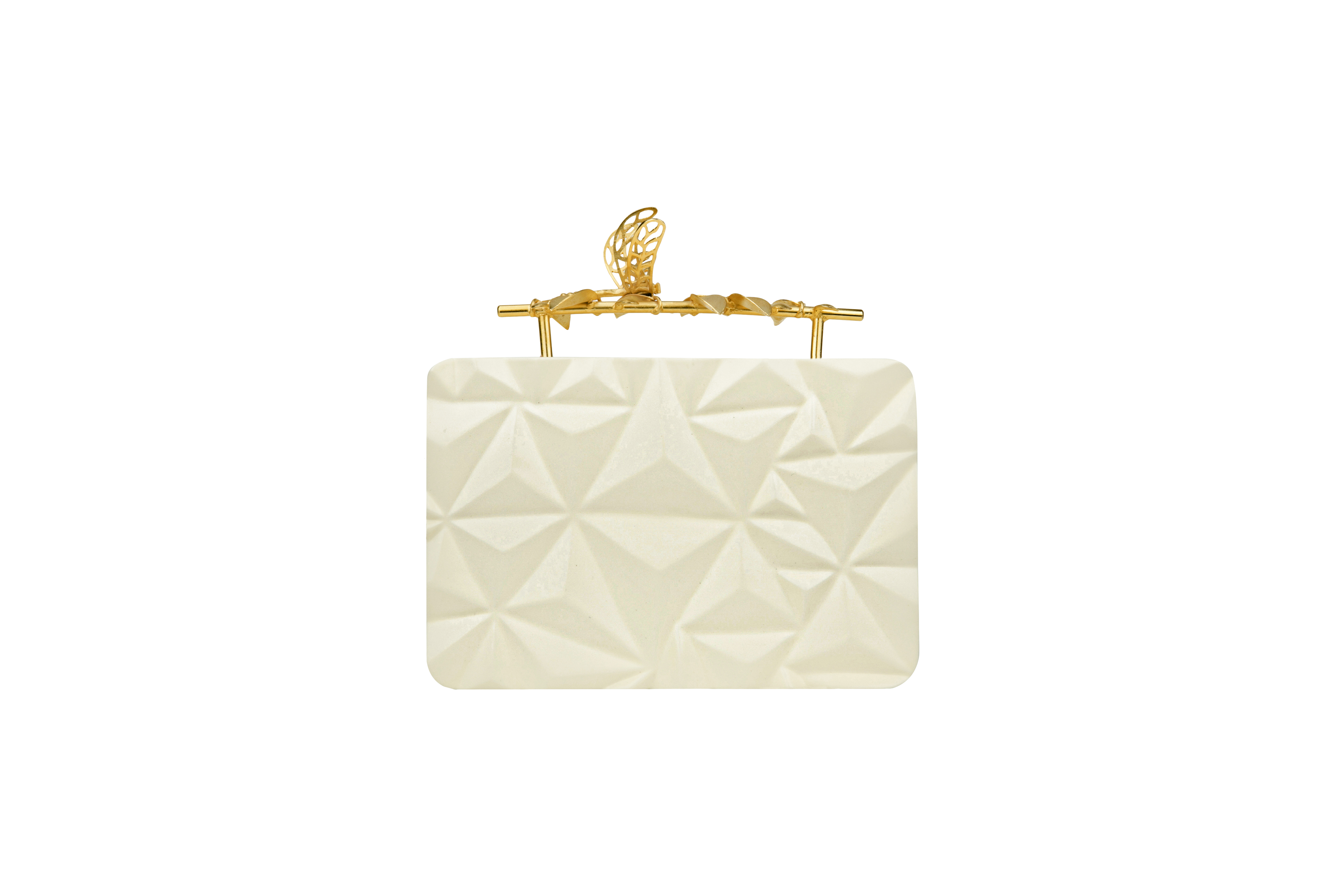 Triangle Cream Firefly Clutch by Duet Luxury on curated-crowd.com