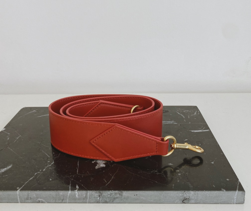 Le Book in Dark Red with Gold Metal Handle by APEDE MOD on curated-crowd.com