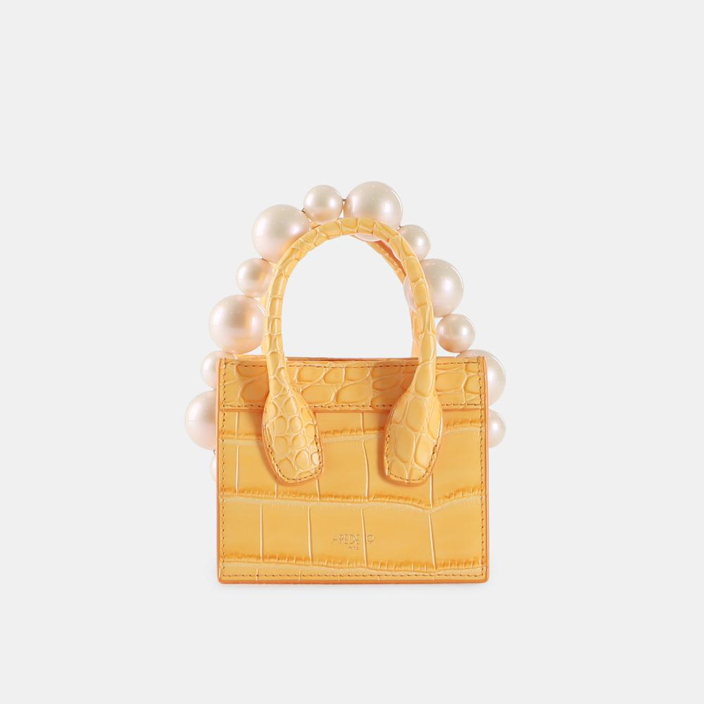Coral Croc Poker Face Mini Tote by APEDE MOD on curated-crowd.com