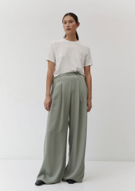 Pleated Trousers in Sage Tencel by The Array on curated-crowd.com