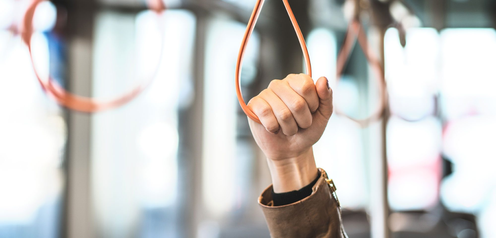 Hand holding strap