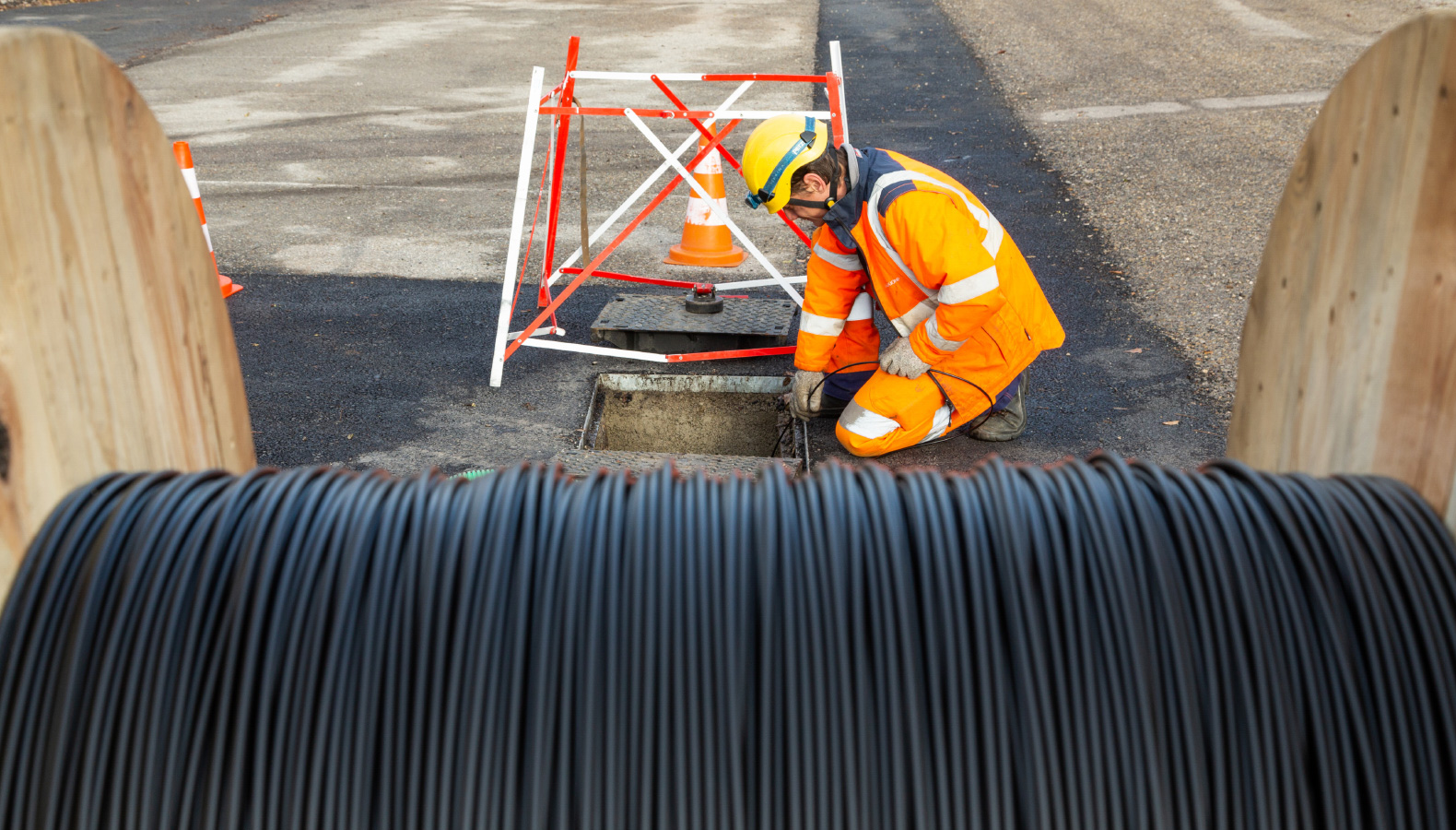 Cable obstructing worker at a manhole