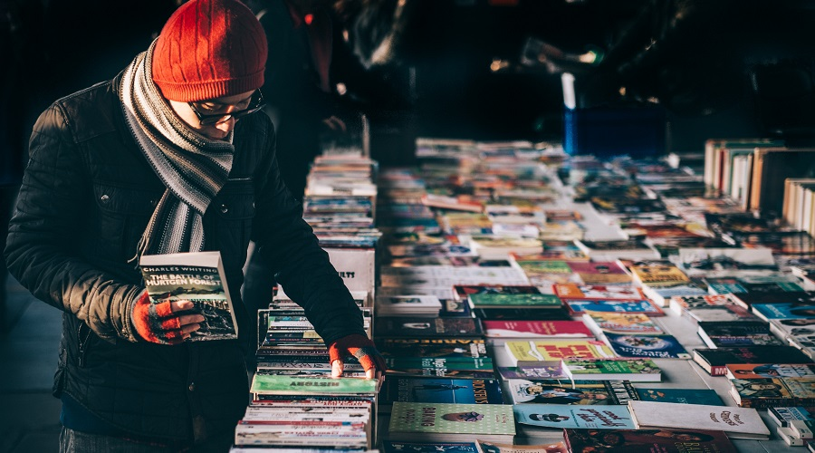Man looking at bookstall in London