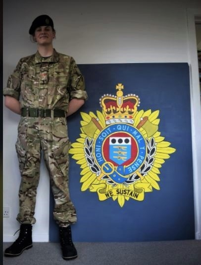 LCpl Burke with his painting