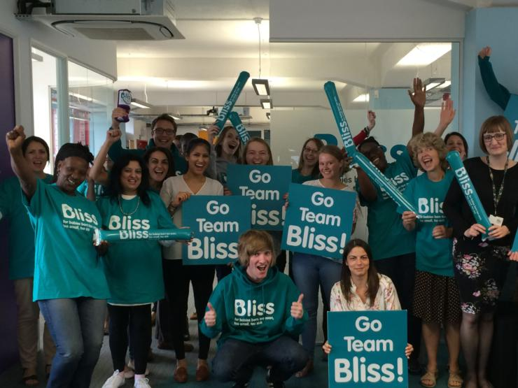 Bliss staff holding Go Team Bliss banners