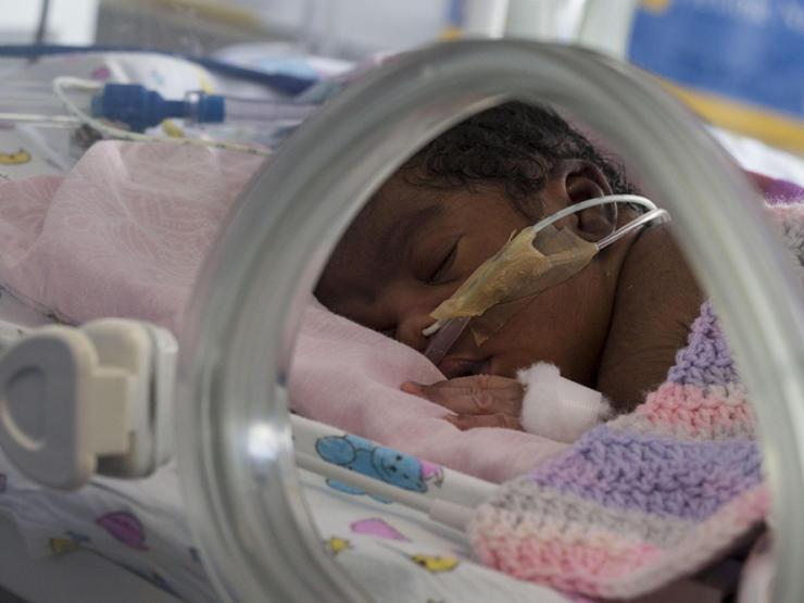 Baby in incubator asleep