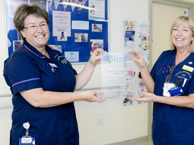 Nurses holding a Bliss accreditation certificate