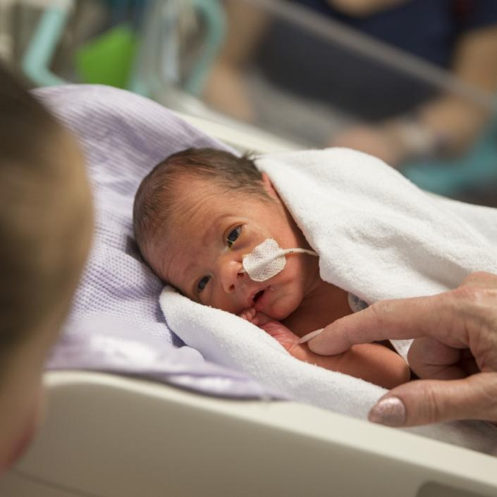 Baby in hospital looking at mum