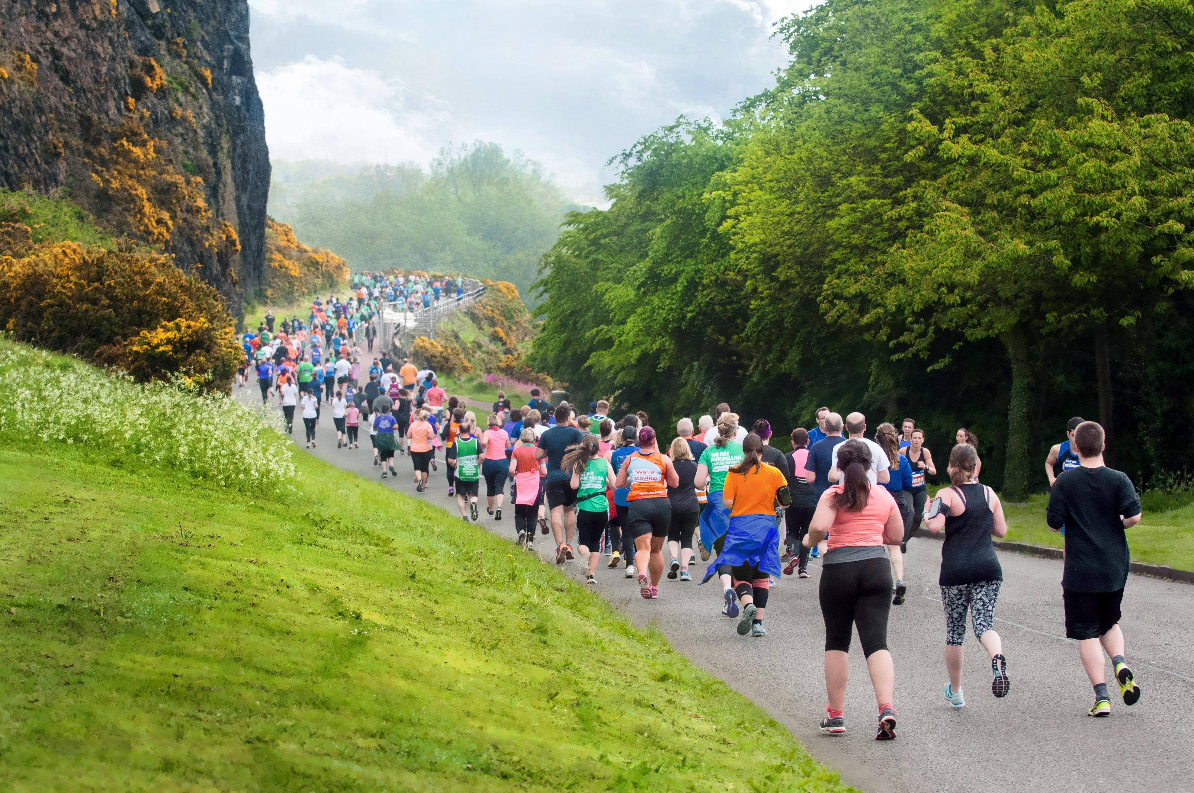 Runners in the Edinburgh Marathon at Arthur Seat