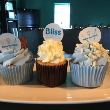 Three cupcakes with Bliss cake labels