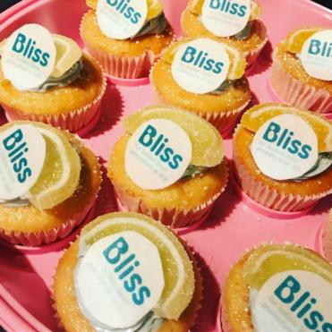 Fairy cakes with orange slices and Bliss cake labels