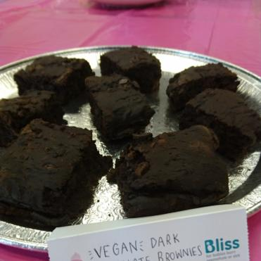 Chocolate brownies with label which says vegan dark chocolate brownies