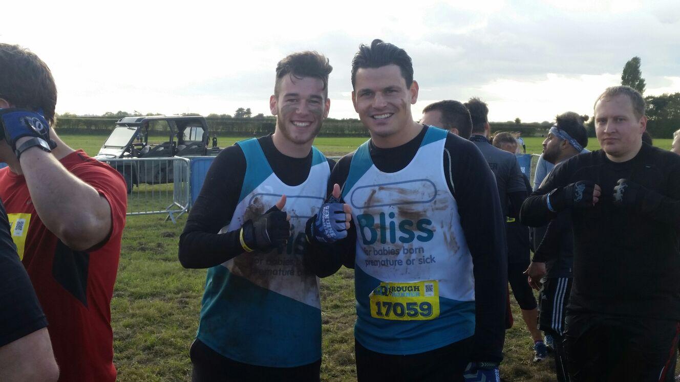 Two muddy runners