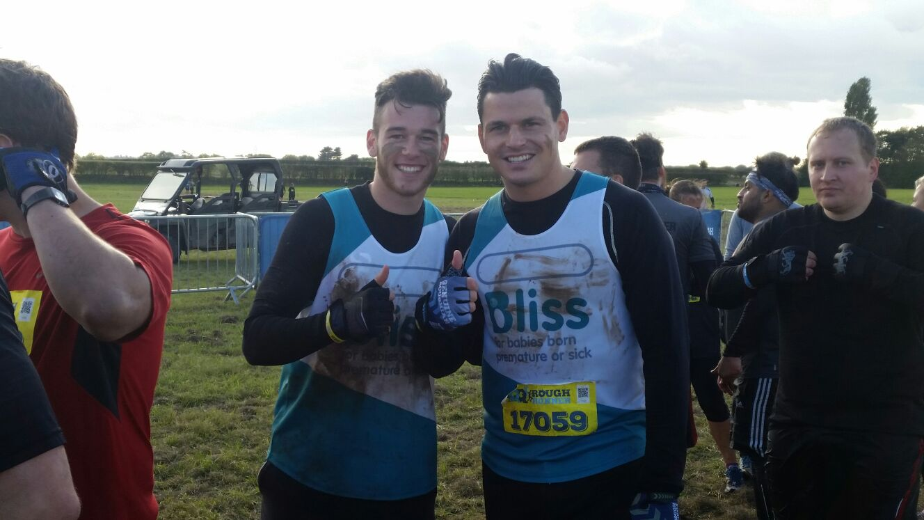 Two muddy runners