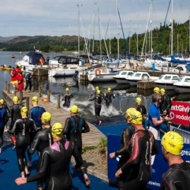 Swimmers in yellow hats ready to start