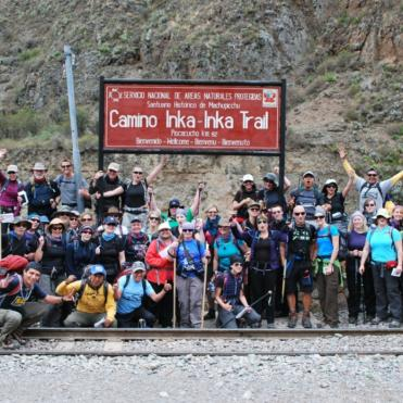 Group of trekkers gathering for a photo