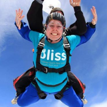 Supporter in the air during her skydive