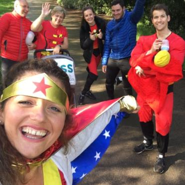 Group of adults dressed in superhero outfits on Little Heroes walk