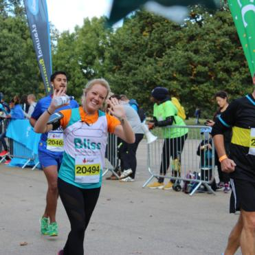 Lady running the Royal Parks Half