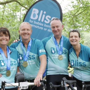 4 Bliss riders with medals at the finish