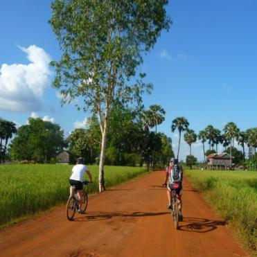2 riders riding through Vietnam