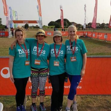 4 ladies in Bliss t-shirts at the finish