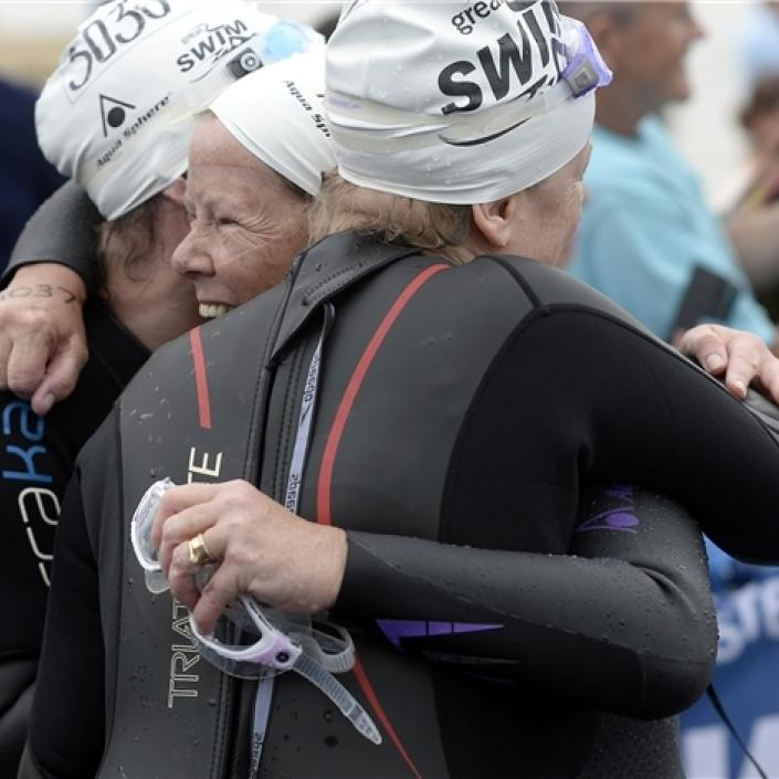 Swimmers hugging