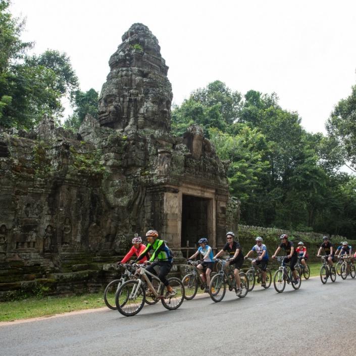 Cyclists riding through Cambodia