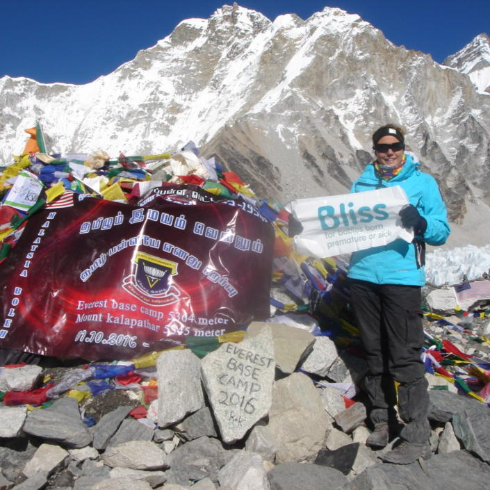 Trekker at the summit of Everest Base camp