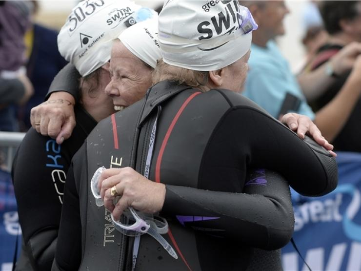 Swimmers hugging