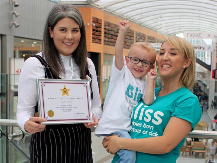 Bliss volunteer Coady with her son Matthew receiving an award for all her community fundraising