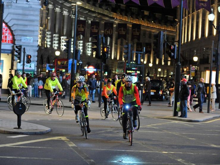 Rider cycling at night