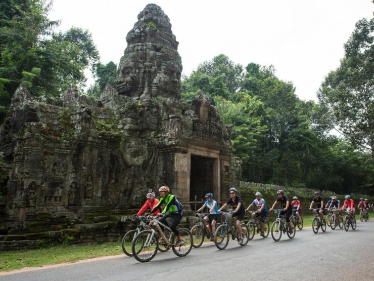 Cyclists riding through Cambodia