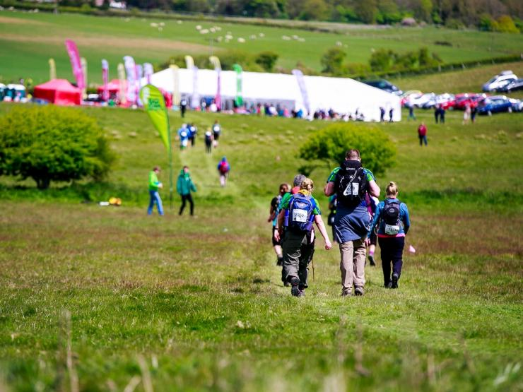 Walkers across the fields toward the finish