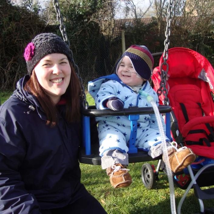 Mum With Baby In Swing Outside