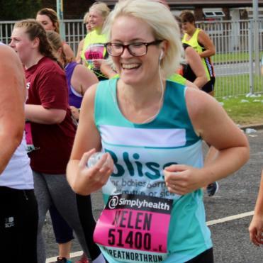 woman wearing glasses smiling as she runs