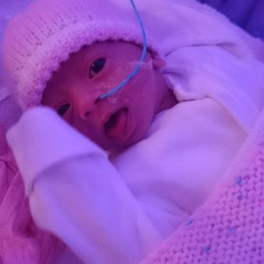 Sister Isabelle when she was in NICU as a baby