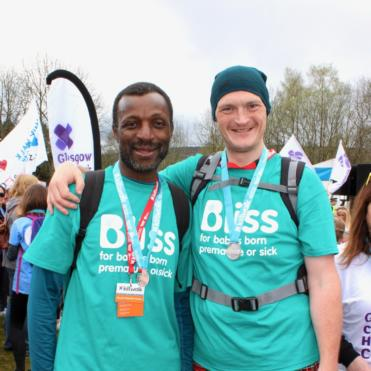 Two men in Bliss t-shirts at the finish line of the Glasgow Kiltwalk