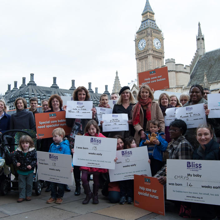Campaigners outside Houses of Parliament with Bliss campaigning boards