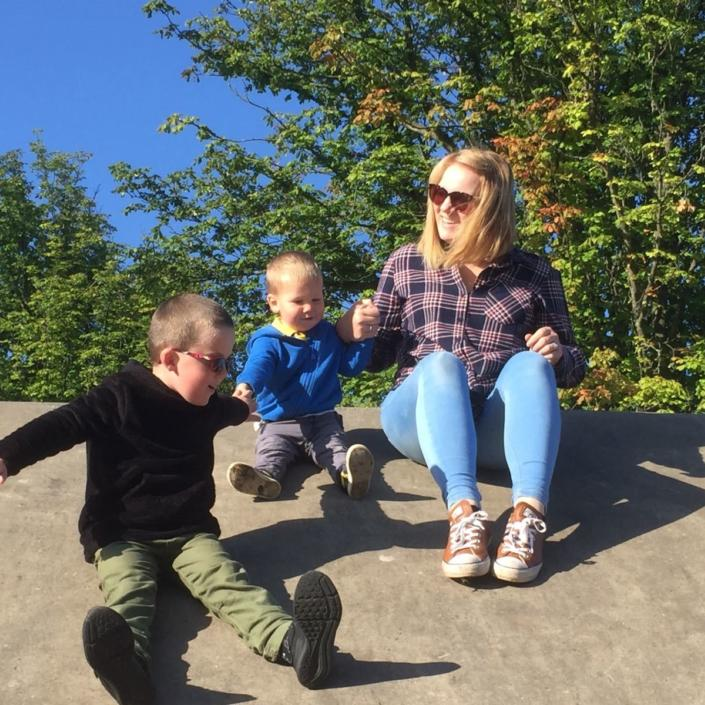 Bliss Champion Linda playing with two boys outside