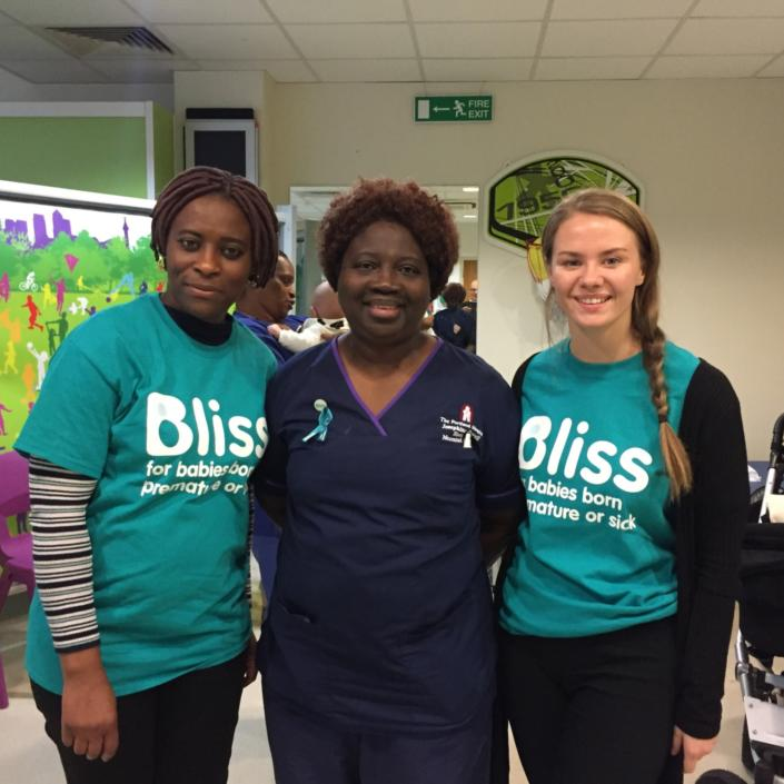 two women in Bliss t-shirts standing with a nurse at a world prematurity day fundraiser