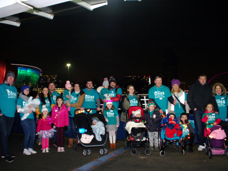 Group of Little Lights walkers standing in front of SSE Hydro in Glasgow