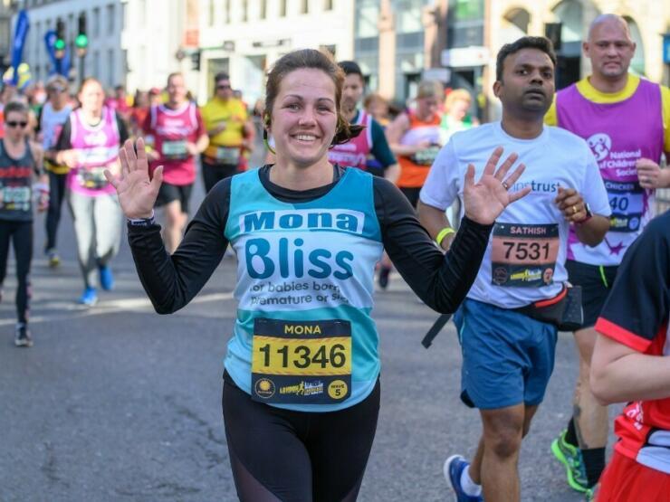 Runner waving at the camera