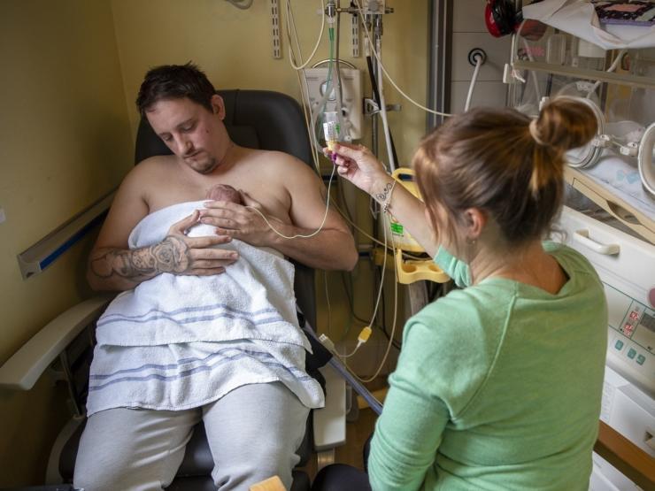 Parents doing skin-to-skin and tube feeding