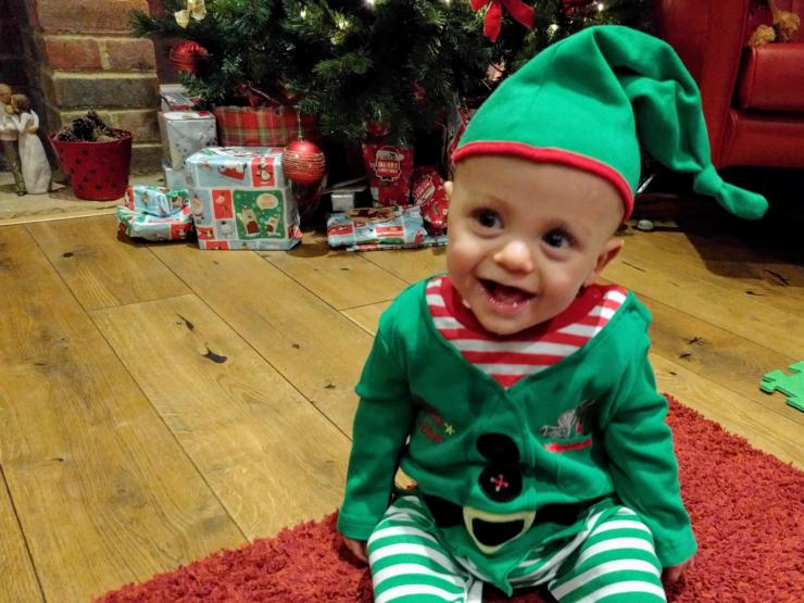 Baby dressed as an elf