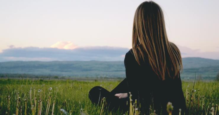 Woman Wearing Black Long Sleeved Shirt Sitting On Green 691919