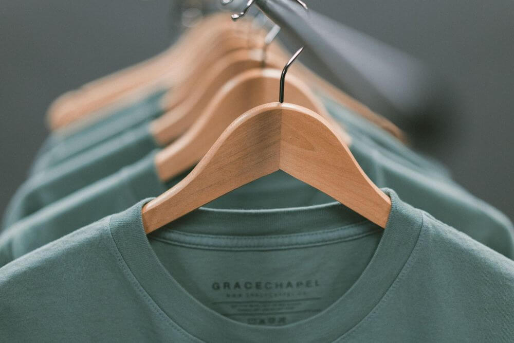 tshirts manufacturing green on hanger