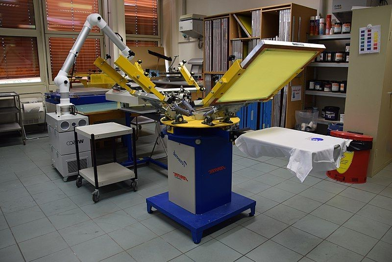 High-tech screen printer in a printing shop with other related equipment